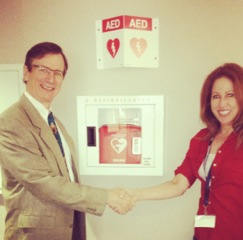 Superintendent Picard and Lori Lopez of HeartReady dedicating the new AED installation at the District Office.