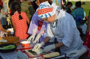 Setsuko Takemoto, from Japan, making sushi at Cherry Chase