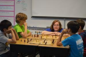 Teacher, Mrs. Grigoryev, teaching a chess class