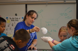 Teacher, Ms. Faure, blowing bubbles with dry ice