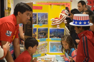 Children visiting a booth at Cumberland's International Night