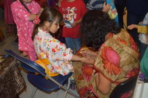 Child getting a henna tattoo at Cumberland's International Night