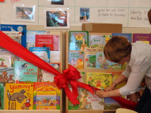 Ellen Levitas, Beth Levitas Longwell's mother, cuts the ribbon during a dedication ceremony, where 30 books were donated to a Vargas kindergarten class.