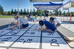 Group paints periodic table of elements on school blacktop