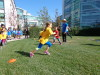 Fifth grader, Naomi Nishikawa, engages in healthy, productive play facilitated by Playworks and Google volunteers on Google's Sunnyvale campus.