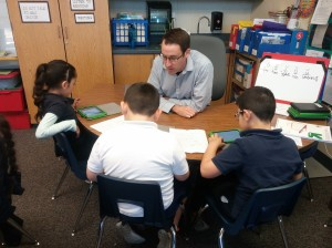 Jonathan Watts spending time in the classroom with San Miguel Elementary students.