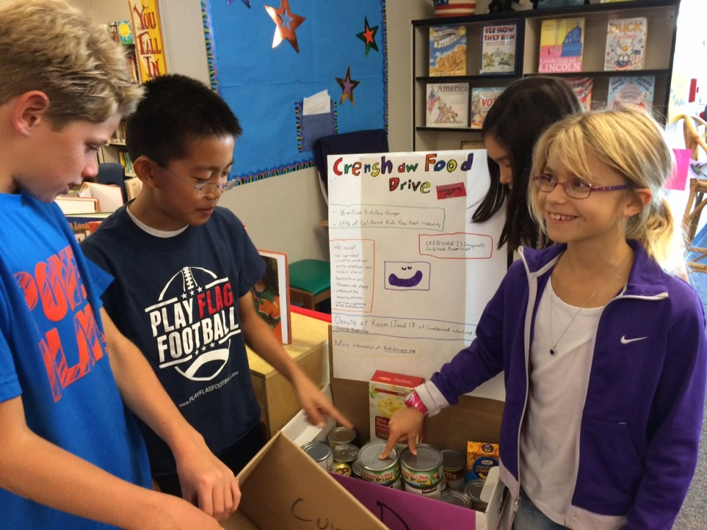 Students collect cans for food drive project