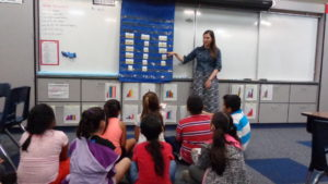 Lakewood Elementary Teacher Sydney Nelson works on literacy skills with students in the YMCA Summer Learning Program.