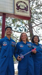 Treyton Kealalio-Puli, Teacher Julia Shotwell, and Marely Esquivel in their space suits that they got to take home with them after attending Space Camp this summer.