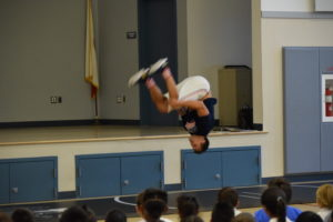 Olympian Jake Herbert shows students his gymnastic skills which lend themselves well in wrestling.