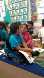 Bishop students explain their interpretations of a book they read in class, while parents observe.