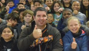 Bryan Stow poses with Sunnyvale Middle students after sharing his presentation about bullying prevention