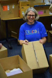 Teachers and library resource specialists assemble hundreds of boxes containing new science unit developed for Sunnyvale students by Sunnyvale teachers.