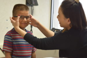 Young boy gets new glasses