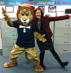 Principal poses with school mascot