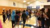 New sixth grade students welcomed by older students