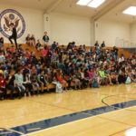 sixth grade students informed by eighth grade students on what to expect in SMS gym