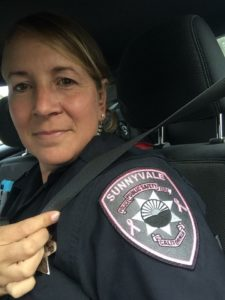 Officer Amy Pistor wearing her pink patch in observation of breast cancer awareness month