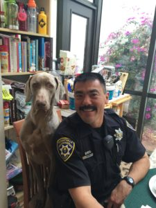 Officer Eric Fuji with his dog, Atticus