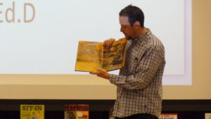 Teacher Kevin Davis reads aloud Take a picture of me, James Van der Zee