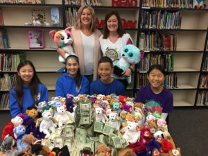 students bring in money to donate to a charity of their choice