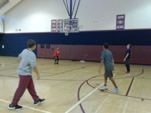 CMS students play basketball with police officers and community services coordinators