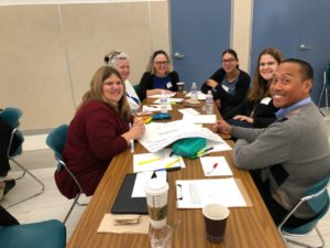 Fairwood principal, staff and parents working together reviewing district goals