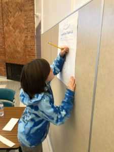 middle school student shares feedback at annual stakeholder lyceum