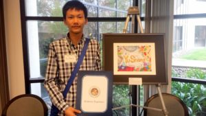 Yu Sheng at bilingual symposium with art