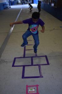 student hopscotching