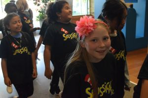 Student performers arrive to sing songs from Seussical