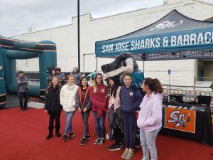 SMS singers meet Sharkie at Sunnyvale Ice Rink