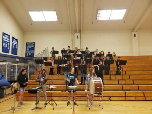 SMS symphonic band play during staff vs. student basketball game