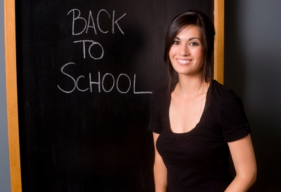 teacher in front of her chalkboard