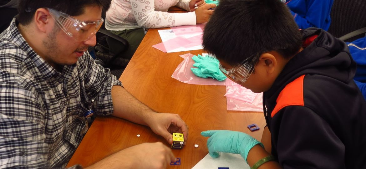 engineer works with CMS student on fidget cube