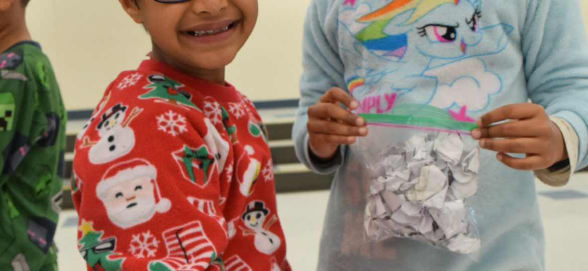 first grade students have fun with pretend snowball fight