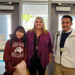 Japanese exchange student wears CMS sweartshirt, poses with principal
