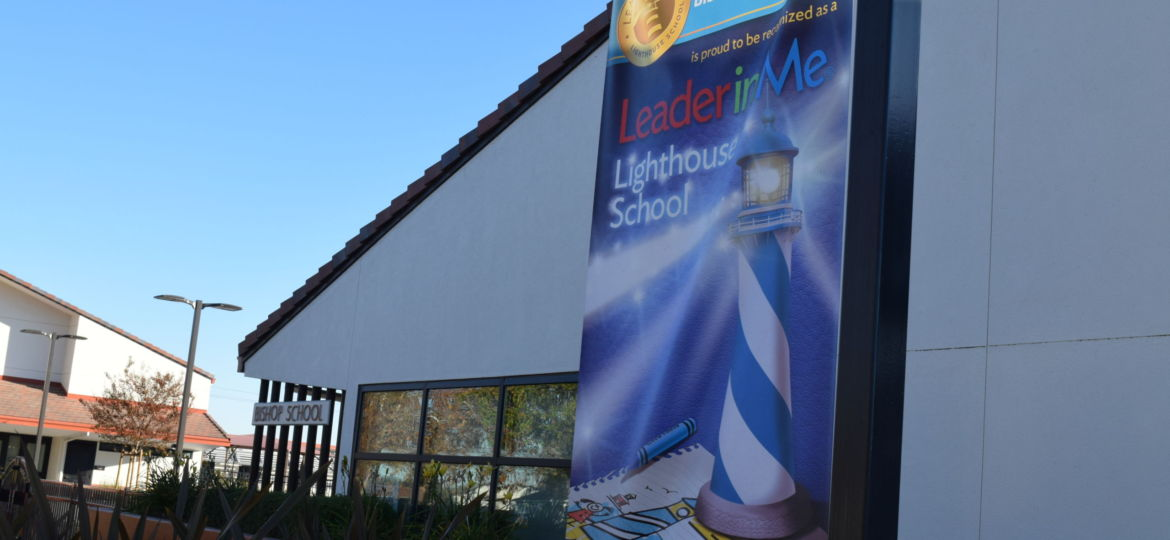 lighthouse banner hangs outside of bishop elementary