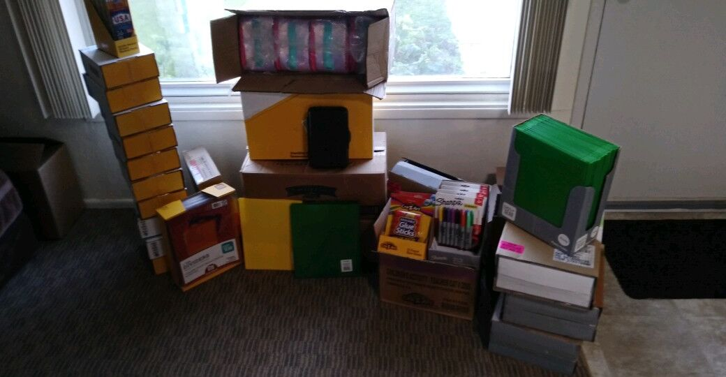 pile of school supplies donations